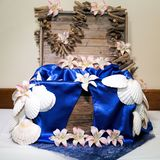 Wedding Box To Receive Gifts Of Money. Wooden box decorated in a beach theme with shells, orchids and driftwood for guests to gift money to the bride and groom royalty free stock photo