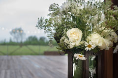 Wooden box with decorative white flowers Royalty Free Stock Images