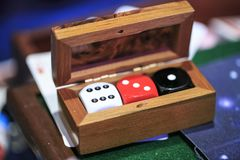 Wooden box with dices inside royalty free stock images