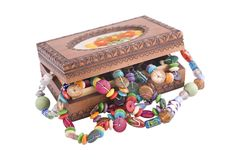 Wooden box with fashion beads Royalty Free Stock Photos