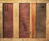 Wooden box with fragile and freight signs Royalty Free Stock Photo