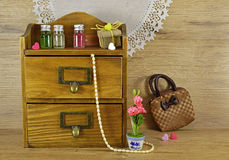 Wooden box with fragrances. Vintage still live with wooden box, perfume bottles and ladies accessories Stock Images