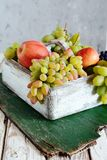 Wooden box with fragrant ripe apples and grapes  Fruit Basket. Natural Organic Fruit Royalty Free Stock Photos