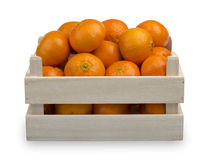A wooden box with fresh mandarines isolated. A wooden box with fresh mandarines isolated on the white background Stock Photography