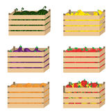 Wooden box with fruits and vegetables. Wooden box with fruits and vegetables on isolated background Royalty Free Stock Photo
