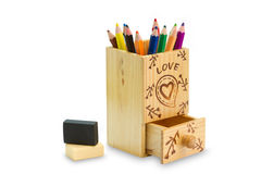 Wooden box full of colorful pencils Stock Images