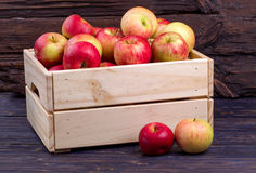 Wooden box full of fresh apples on a wooden background Royalty Free Stock Photos