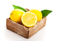 Wooden box full of lemons Royalty Free Stock Photo