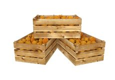 Wooden box full of peach fruit. Isolated on white background. stock photos