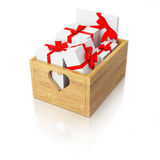Wooden box full of presents Royalty Free Stock Images
