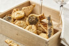 A wooden box full of salty cheese cookies Stock Image