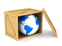 Wooden box with globe Stock Photo