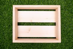 Wooden Box with Green Grass. A Wooden Box with Green Grass Royalty Free Stock Images