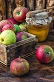 Honey Spas mix. Wooden box with the harvest of apples and honey for the holiday apple spas.Photo tinted Royalty Free Stock Image