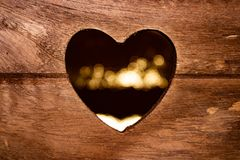 Wooden box with the heart-shaped hole stock photo