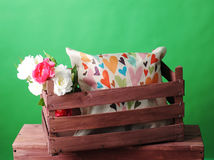 Wooden box with an interior pillow and a bouquet of flowers Stock Photos