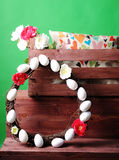 Wooden box with an interior pillow and a bouquet of flowers Stock Image