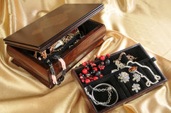 Wooden box with jewelry Stock Image