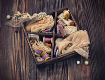 Wooden box with laces, ribbons and threads Royalty Free Stock Photography