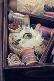 Wooden box with laces, ribbons and threads Stock Image