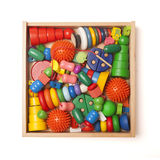 Wooden box with many toys Royalty Free Stock Photo