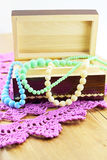 Wooden box with necklaces Stock Photo