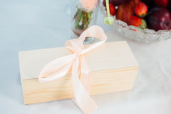 Wooden box of notes for a wedding. With a bow Royalty Free Stock Photos
