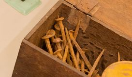 Wooden box with old rusty nails. Selective focus Stock Images