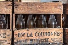 NEERIJSE, BELGIUM - SEPTEMBER 05, 2014: Wooden box with old vintage beer bottles in the brewery De Kroon in Neerijse. royalty free stock image