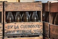 NEERIJSE, BELGIUM - SEPTEMBER 05, 2014: Wooden box with old vintage beer bottles in the brewery De Kroon in Neerijse. royalty free stock photo
