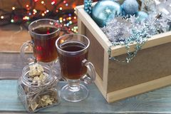A wooden box with ornaments and two cups of tea royalty free stock image