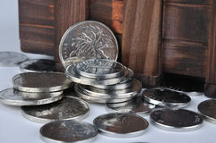 Wooden box part and coins Stock Photos