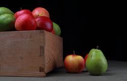 Wooden box with pears and apples Royalty Free Stock Photos