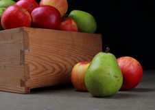 Wooden box with pears and apples Royalty Free Stock Photo