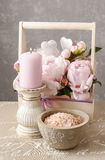 Wooden box with pink peonies, scented candle and bowl of sea sal. T. Spa time Royalty Free Stock Photography