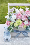 Wooden box with pink and yellow carnations Royalty Free Stock Image