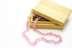 Wooden box with quartz beads Stock Image