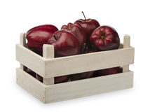 Wooden box with red apples isolatd. Wooden box with red apples isolatd on the white background Royalty Free Stock Image