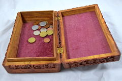 Wooden box with red carpet and coins Royalty Free Stock Photography