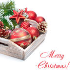 Wooden box with red Christmas decorations and space for text Royalty Free Stock Photos