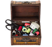 Wooden box with sewing supplies Royalty Free Stock Photography