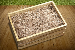 Wooden box with shredded paper Stock Images