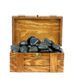Wooden box with  spa stones on a white background Royalty Free Stock Image