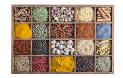Wooden box with spices and herbs on white Royalty Free Stock Photos