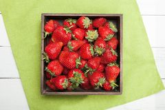 Wooden box with strawberry, colorful delicious diet royalty free stock photo