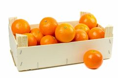 A wooden box of tangerines Stock Photos