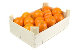 A wooden box of tangerines Stock Images