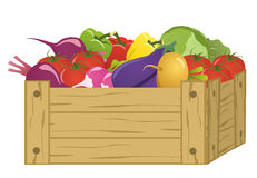 Wooden box with vegetables. On white background Royalty Free Stock Photos