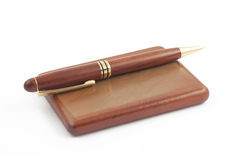 Wooden box for visiting-cards and pen on white Royalty Free Stock Photos