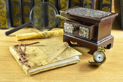 Wooden box with watch and notepad Royalty Free Stock Photo